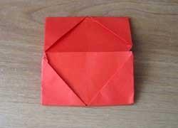 1469718660_perviy-sposob-5 Как сделать из бумаги кошелёк, портмоне, конверт для бумажных денег и мелочи своими руками? Как сделать волшебный кошелек из бумаги: схема с описанием